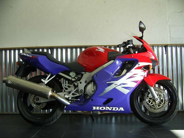 Blue, white and red Honda CBR600 F4